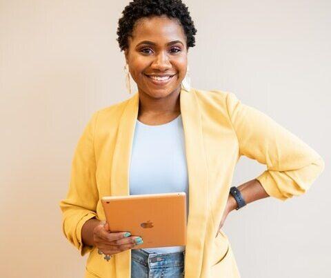 Financial Joy School Woman-holding-iPad-480x600-1-480x403 How to Invest 100 Dollars